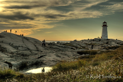 Peggy's Cove Lighthouse - HDR. Note ghosting due to movement of people between exposures. © Rob Huntley