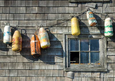 Buoys hanging on a wall. Peggy's Cove, NS.