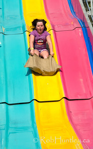 Child on a fairground slide.