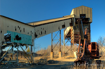 Derelict building and digger at the Marmora Iron Mine, Marmora, Ontario. HDR - high dynamic range (3 exposures mapped into one).  © Rob Huntley