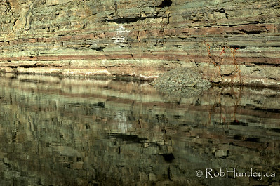 Reflection in the lake of the wall of the Marmora Iron Mine, Marmora, Ontario. HDR - high dynamic range (3 exposures mapped into one).  © Rob Huntley