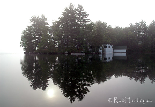 Misty morning sunrise on Lake Joseph in the Muskokas.