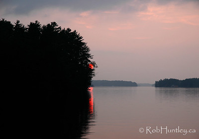 Half a sunset on Lake Joseph in the Muskokas. © Rob Huntley