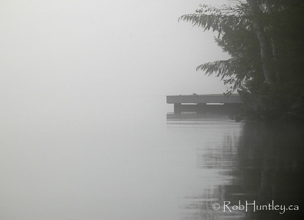 Cottage dock in the mist. Muskoka.