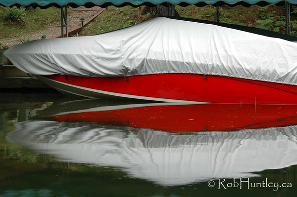 Covered boat on Lake Joseph in the Muskokas. © Rob Huntley