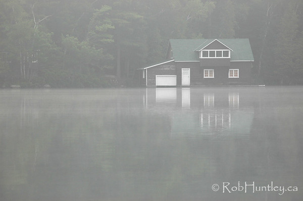 Cottage boathouse in the mist - morning on Lake Joseph in the Muskokas.