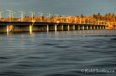 Champlain Bridge in the late fall just after sunrise. Quebec is on the far side. The picture is taken from Bate Island. HDR © Rob Huntley
