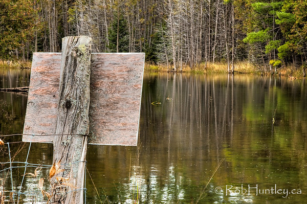 Rustic Sign from behind. Sign at the edge of a mill pond warning of fast moving water ahead and private property. I feel fortunate to have access to this beautiful area. It is private property of a friend of a friend. © Rob Huntley
