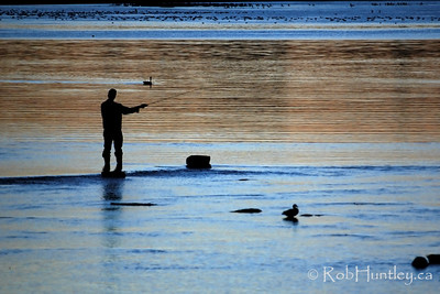 Fishing at dusk. Remic Rapids on the Ottawa River near Tunney's Pasture. © Rob Huntley