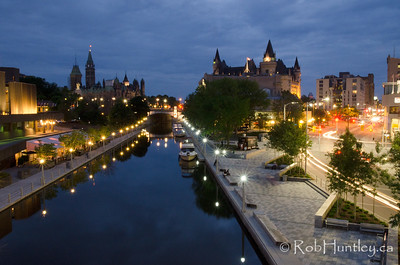 Calm and Frenetic, City of Ottawa from the Mackenzie Bridge. On one side the calmness of the Rideau Canal, on the other side the busy traffic of Colonel By Drive and Sussex Drive. National Arts Centre on the left, Parliament Buildings and the Chateau Laurier Hotel. © Rob Huntley
