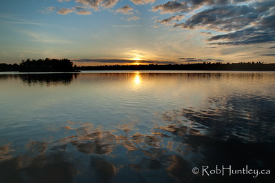 Sunset at dock level on Black Lake near Perth, Ontario.