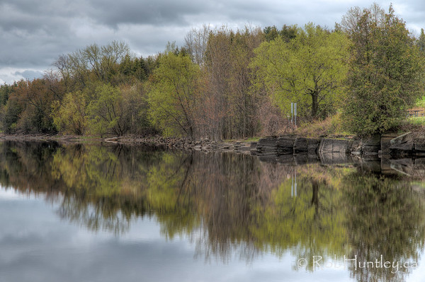 Reflection of the Ottawa River shoreline at Pinhey's Point Heritage Property and Park. License this photo on Getty Images © Rob Huntley 2012