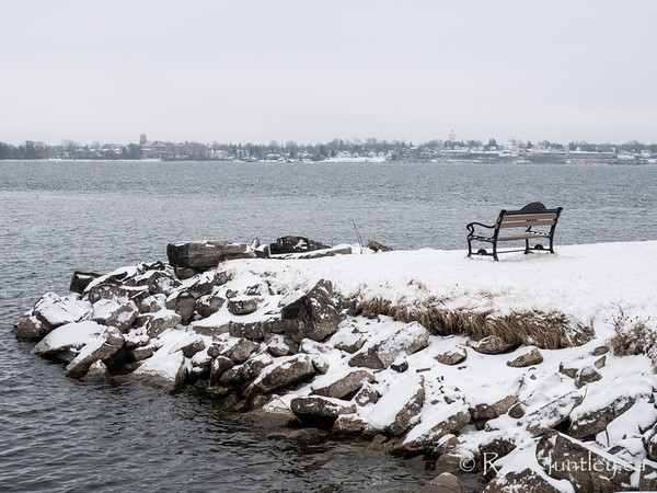 Bench with a view on the Saint Lawrence River in Winter
