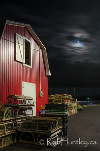Nighttime on the wharf. Moon over French River, Prince Edward Island.