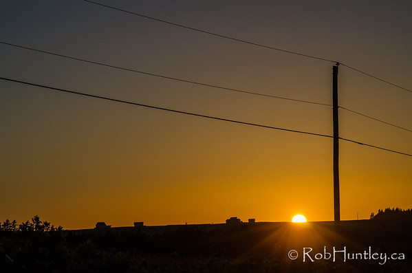 Sunset and Telephone Post
