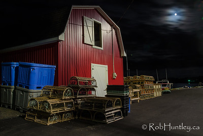 Nighttime moon on the wharf. French River, Prince Edward Island.