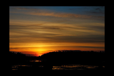 """Métis-sur-Mer, Qc, Canada: """"Métis-sur-Mer s'enflame lorsque la nuit arrive"""", Métis-sur-Mer est un village sur les rives du fleuve St-Laurent. Photo prise à marée basse dans une baie. / """"Métis-sur-Mer burning at sunset"""", Métis-sur-Mer is a small village along St-Lawrence river. The pictures is at low tide in a bay."""