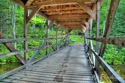 Under the covered bridge. A covered bridge over a stream that connects Big Cedar Lake and Little Cedar Lake near Messines, Quebec.  © Rob Huntley