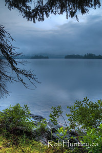 The storm has passed. Calm evening on Big Cedar Lake near Messines, Quebec. A thunderstorm had passed through earlier in the evening.  © Rob Huntley