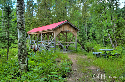 Covered Bridge near Little Cedar Lake. A covered bridge over a stream that connects Big Cedar Lake and Little Cedar Lake near Messines, Quebec.  © Rob Huntley