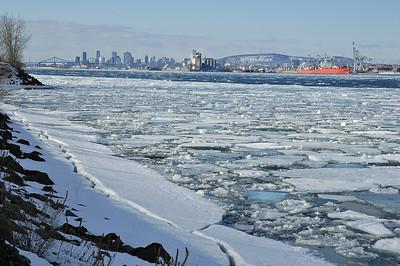 """Montréal, Qc, Canada: View of Montreal from """"Ile Charron"""" on St-Lawrence river. It was a sunny mild winter day. / Vue de Montréal par un beau jour de fin d'hiver. Photo prise de l'Ile Charron dans le fleuve ST-Laurent."""