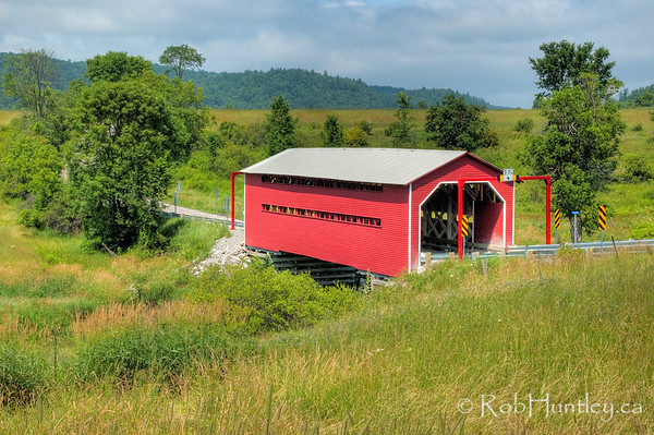 Red Covered Bridge near Wakefield. This is the red covered bridge on Chemin Cross Loop near Gatineau Park. It is near Wakefield, Quebec, but it is not the larger  covered bridge that tourists generally go to see in the town of Wakefield itself.  © Rob Huntley