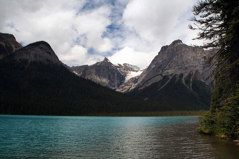 Yesterday's travellers were adventurers in search of the extraordinary. They came by rail and horse-drawn coach to a summer retreat on the shores of exquisite Emerald Lake. Legendary guide Tom Wilson first discovered Emerald Lake in 1882 during the construction of the Canadian Pacific Railway.