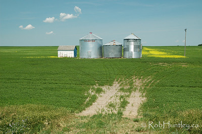 Sheds and storage - agricultural scene in southern Saskatchewan. © Rob Huntley