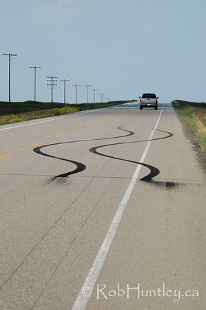 Laying rubber. Leaving tracks on the pavement on a country road in southern Saskatchewan. © Rob Huntley