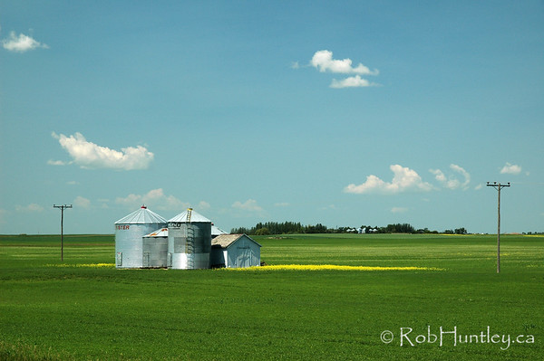 Sheds and storage - agricultural scene in southern Saskatchewan.