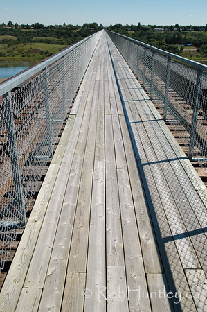 Skytrail over the South Saskatchewan River - Outlook, Saskatchewan. Looking west, the Skytrail is the longest pedestrian bridge in Canada. Skytrail is a key segment of the Trans Canada Trail and is a popular location for birdwatching.  © Rob Huntley