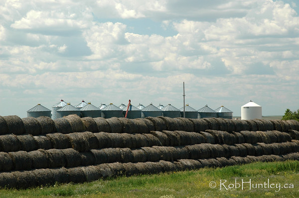 Hay bales stacked four deep on a farm in southern Saskatchewan. © Rob Huntley