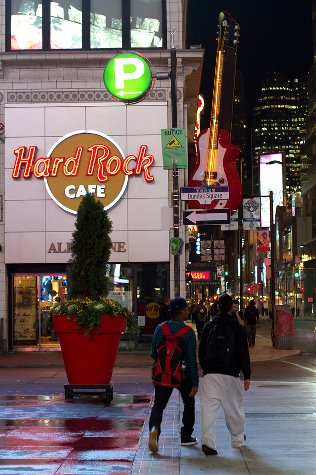 Street walking in front of the Hard Rock