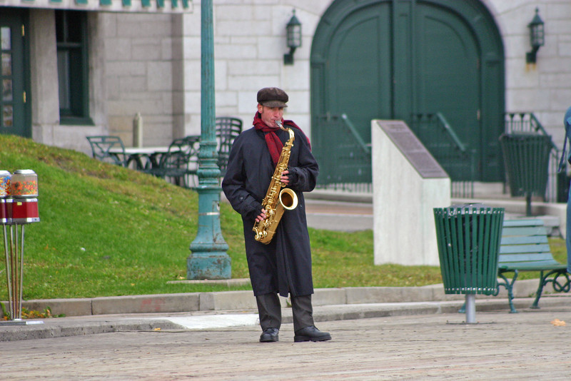 Street musician up by Hotel Frontenac in Quebec City.