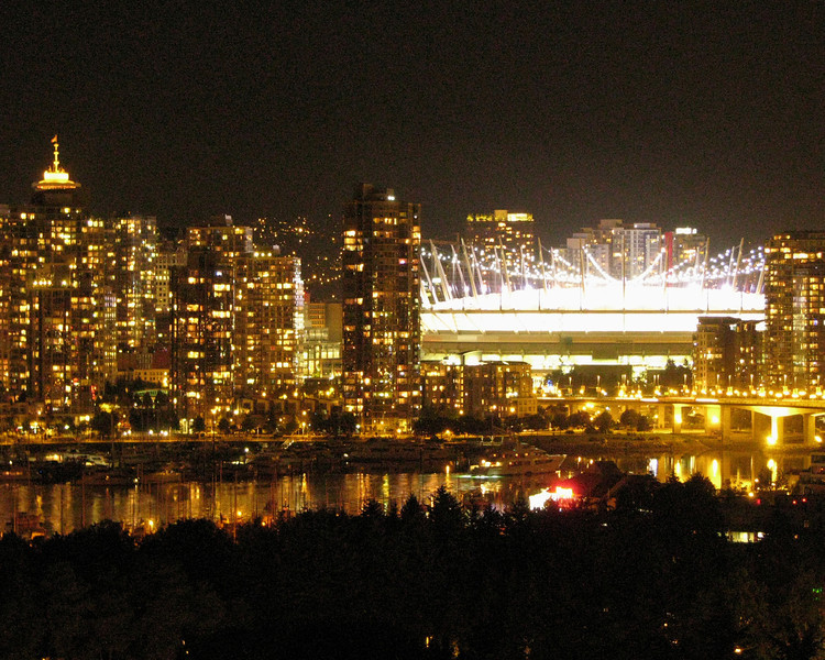 Vancouver, BC night skyline with BC Place (sports arena) fully illuminated.