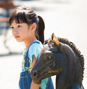 Asian girl and horse statue 3532 in Canada