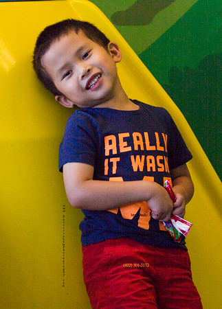 Asian boy on ferry can 3361