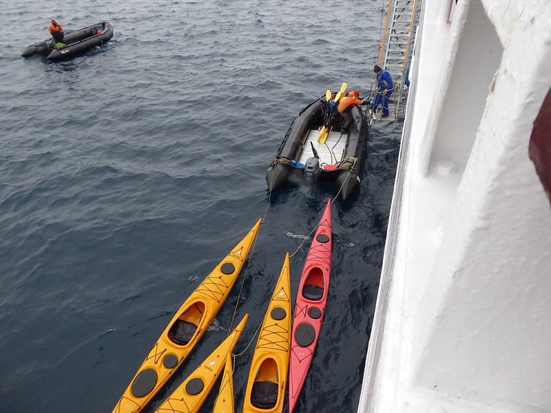 One Zodiac is towing kayaks for those intrepid sea kayakers on the voyage.