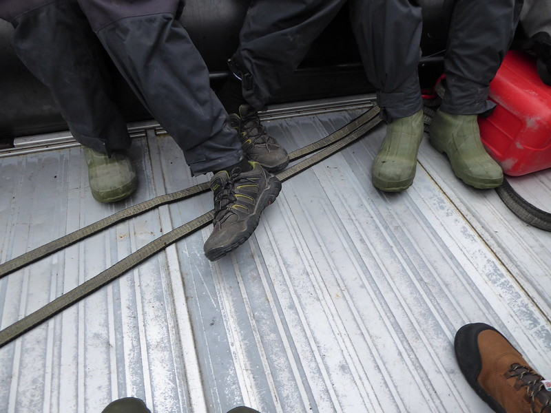 Footwear in the Zodiaks. Mostly ship issued gum boots, but a few other boots as well as we didn't have to wade to shore this time.