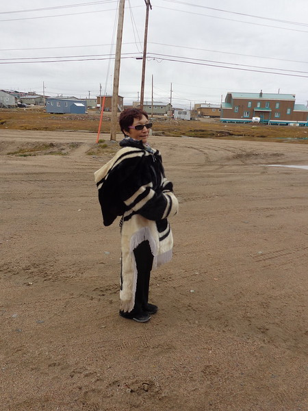 Guide in traditional seal-skin attire.<br /> <br /> A photo borrowed from the ship computer.