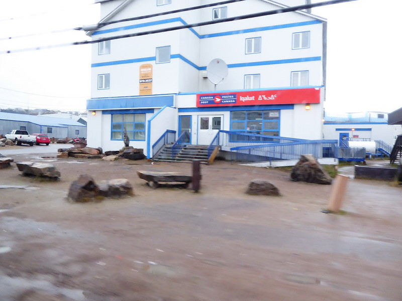 We were taken to the new airport terminal by school bus. These pictures were snapped from the bus. Canada Post. The main streets were paved, but the road to the new airport terminal still needs finishing.