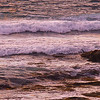 These waves break on a rocky beach