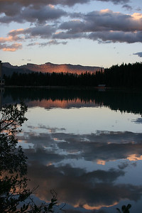 Sunset and alpenglow reflected on Lake Louise