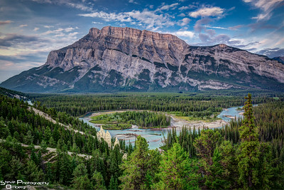 Tunnel Mountain in Banff at sunrise with Bow River and Hoodoos in foreground