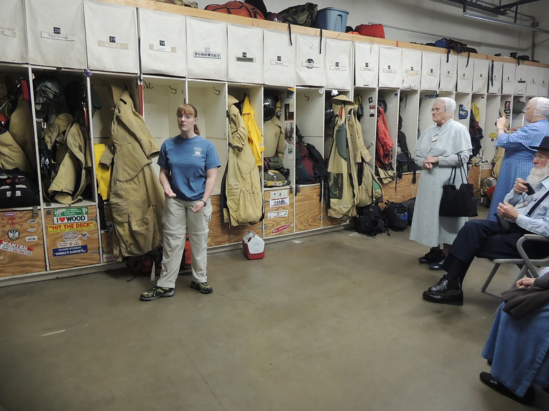 A guide shows us the gear and lockers used by smoke jumpers at the training center near Missoula, Montana.  A day after this visit, 19 smoke jumpers were killed in a dangerous Colorado fire.