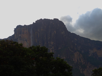 Angel Falls:  It is the world's highest uninterrupted waterfall, with a height of 979 m (3,212 ft) and a plunge of 807 m (2,648 ft). The waterfall drops over the edge of the Auyantepui mountain in the Canaima National Park (Spanish: Parque Nacional Canaima), a UNESCO World Heritage site in the Gran Sabana region of Bolívar State.