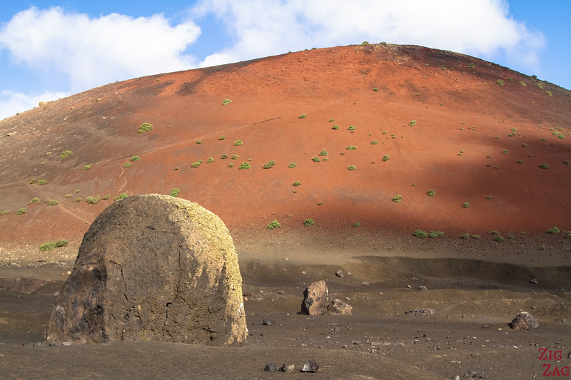 What to see in Lanzarote - Huge volcanic bomb in front of the red volcano Montana Colorada