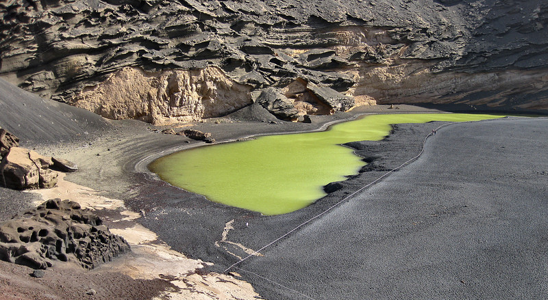 "The Green Lagoon, El Golfo, Lanzarote. Fed from underground by sea water, the colour is caused by algae. Raquel Welch appeared here in the 1966 film <a href=""http://www.imdb.com/title/tt0060782/"">One Million Years B.C.</a> which was shot in the Canaries because of the extensive volcanic landscape."