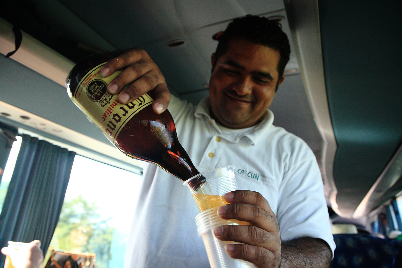 Pedro poured all-you-can drink beer and liquor throughout the bus ride. Having a little Corona Familiar at 10am.