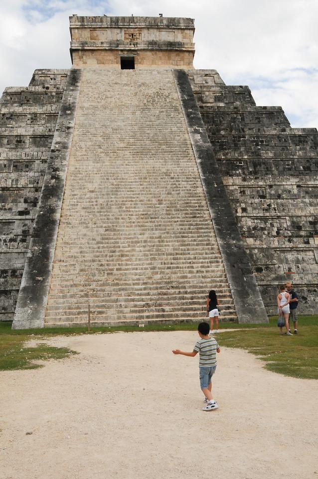 Young boy clapping hands to hear the sound of the sacred Quetzal Bird, Chichén Itzá, Yucatán, Mexico - November 2011